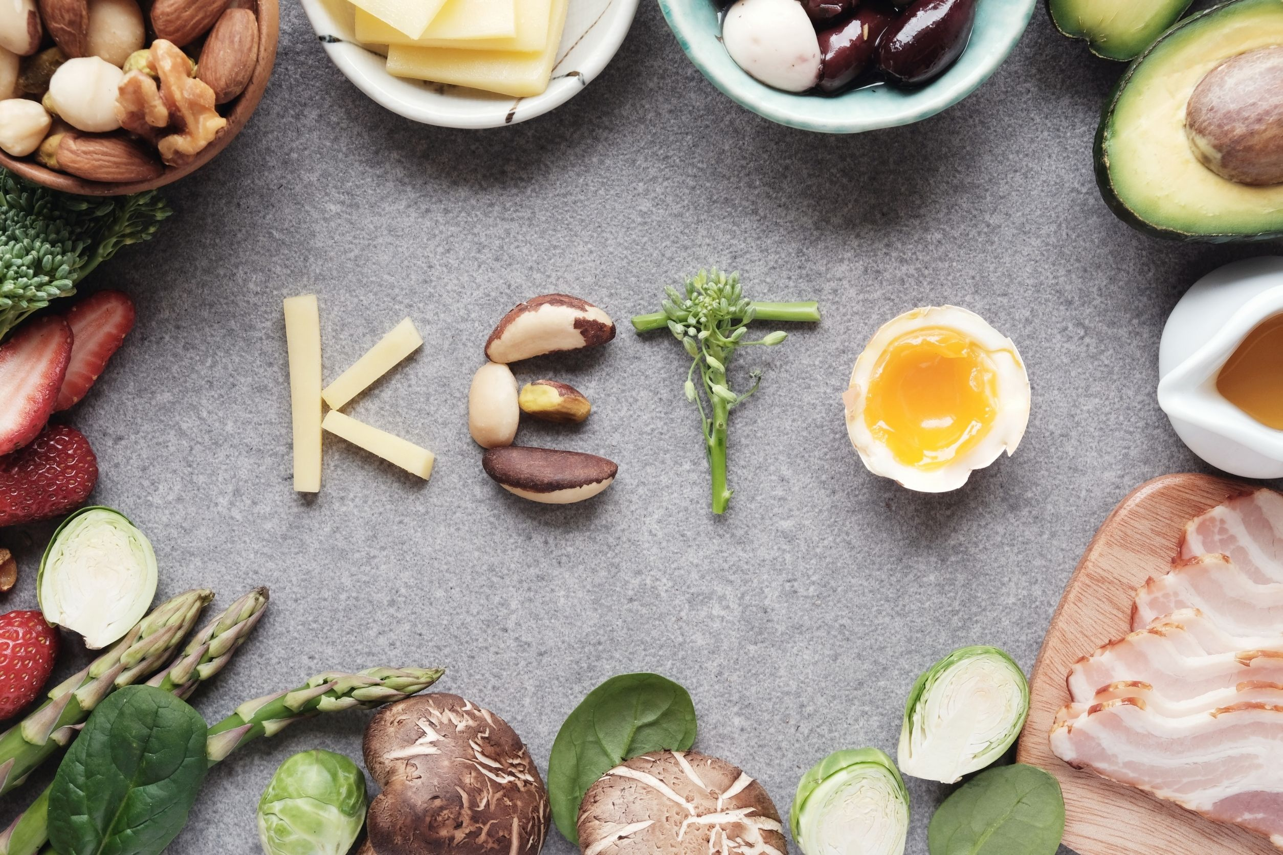 Keto diet foods like eggs, berries, bacon, cheese and vegetables
