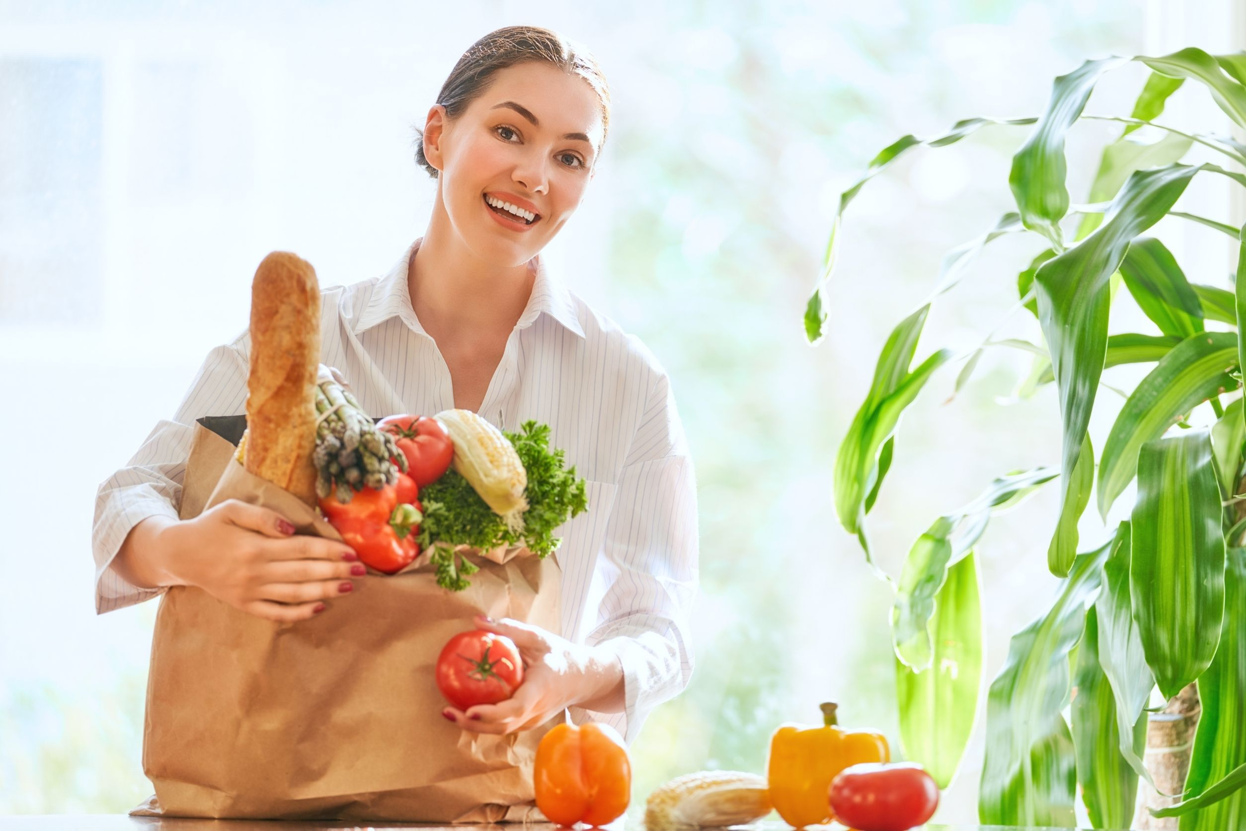 women happy to have purchased vegetables to start her vegan diet