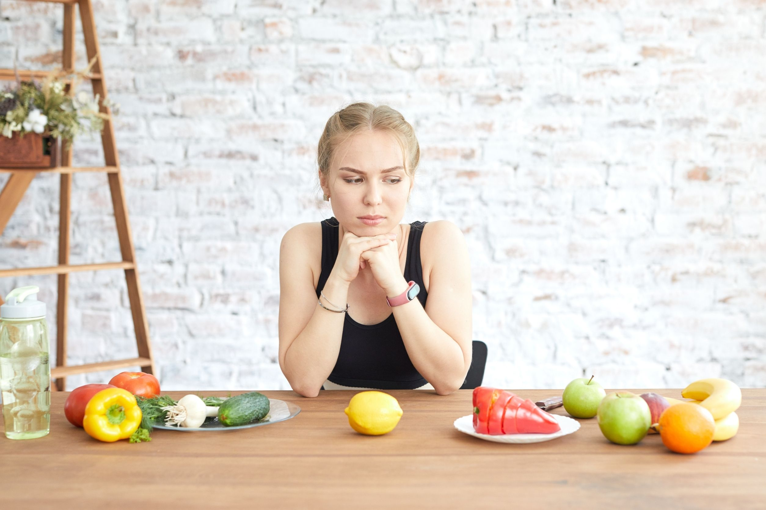 upset woman contemplating to change into healthy eating habits