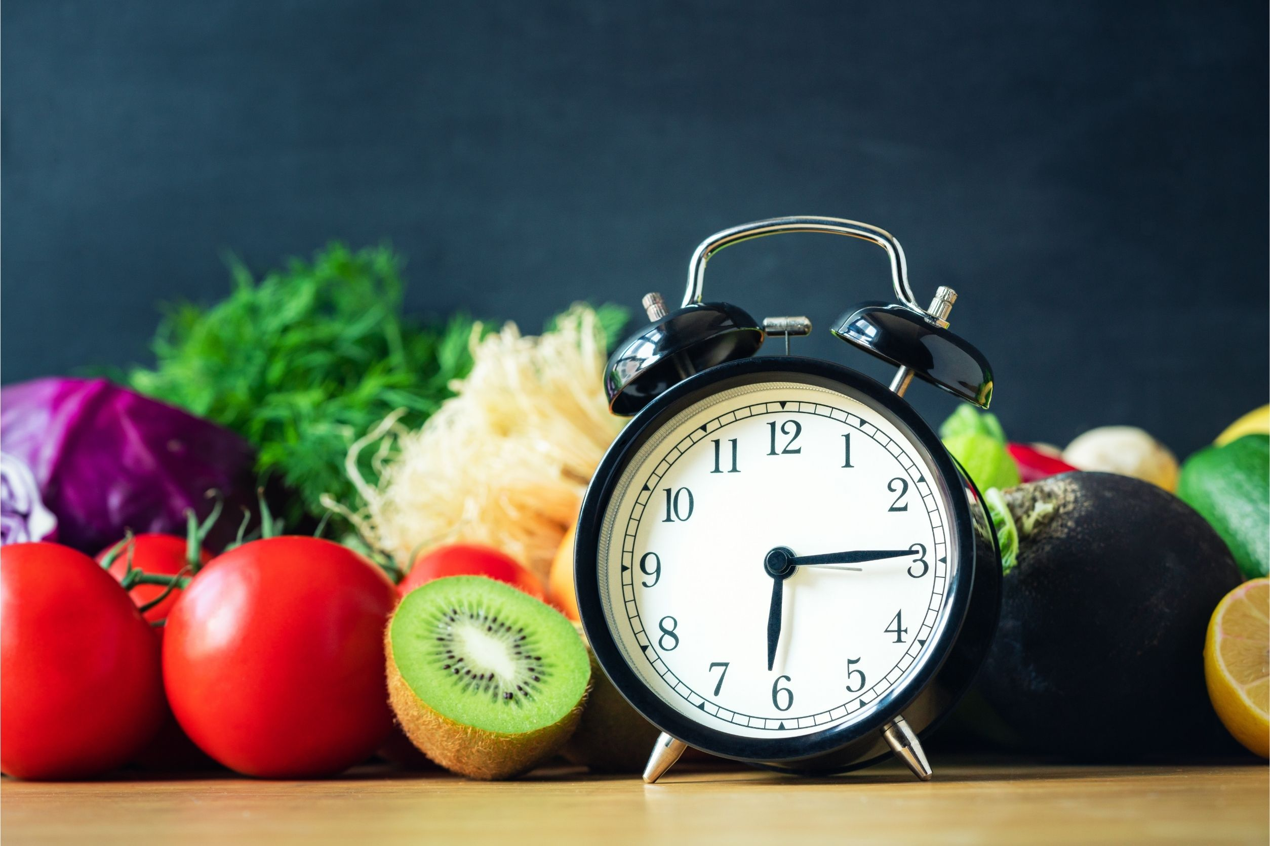 intermittent fasting concept image of clock with healthy foods