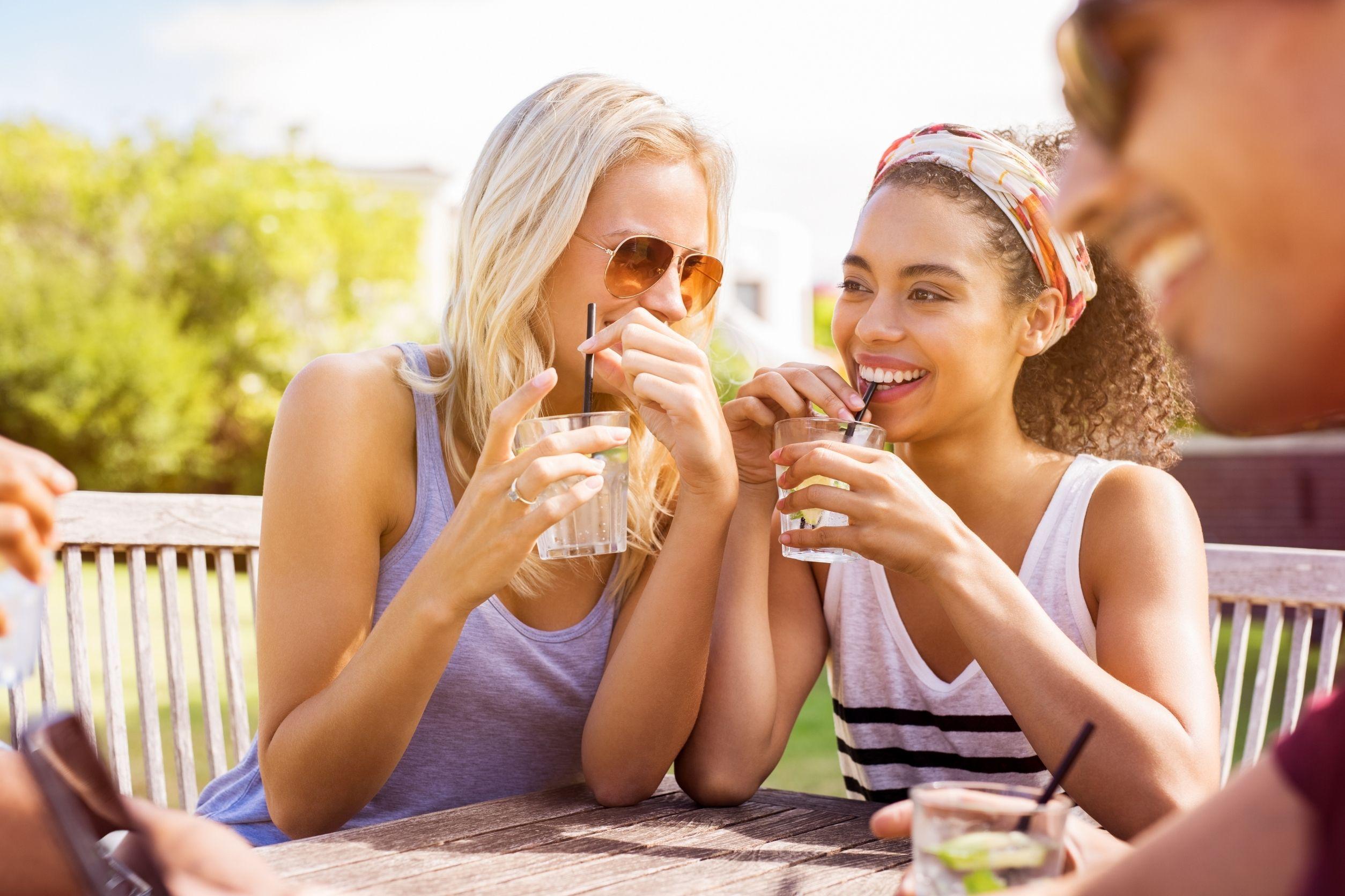 women drinking low-calorie cocktails